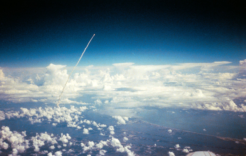 Long range view of an unidentified space shuttle lift off taken from an